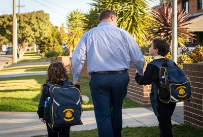 Sydney Catholic Schools Road Safety Education Officer, Andrew Sortwell, walking with his children.